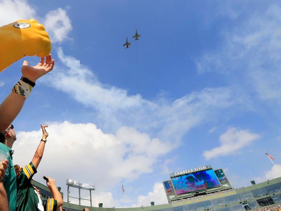 Green Bay Packers fans watch a flyover after the national anthem before the game against the Minnesota Vikings at Lambeau Field on Sunday, September 16, 2018 in Green Bay, Wis.
