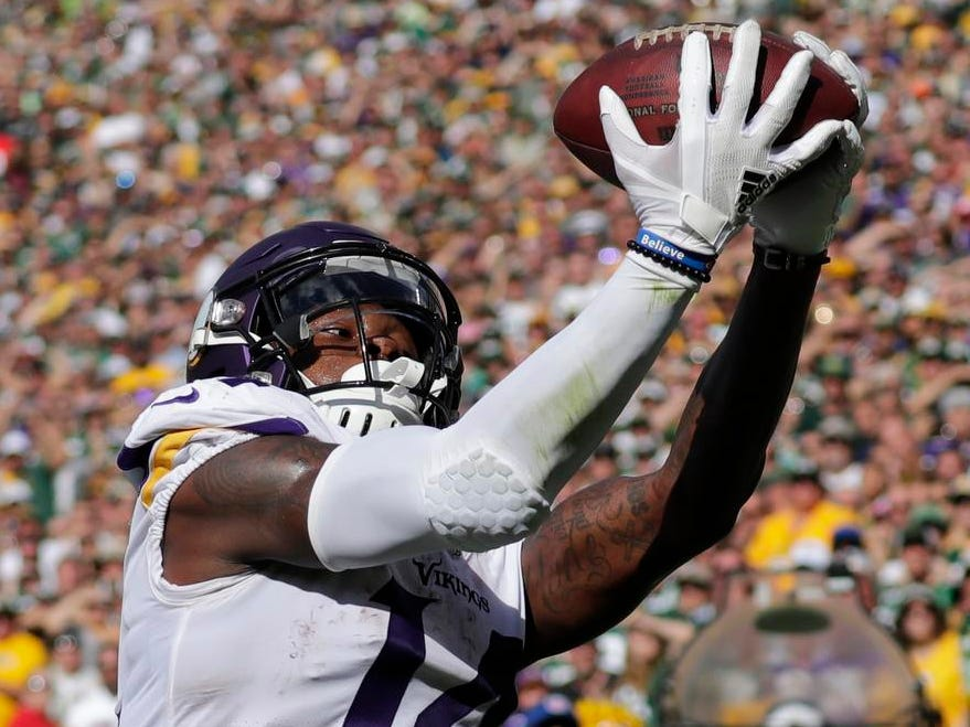 Minnesota Vikings wide receiver Stefon Diggs (14) scores a two-point conversion to tie the game late in the fourth quarter aginst the Green Bay Packers during their football game Sunday, Sept. 16, 2018, at Lambeau Field in Green Bay, Wis.