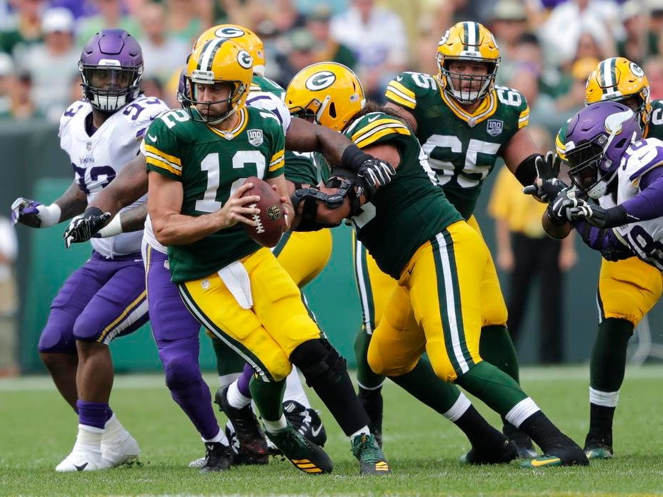 Green Bay Packers quarterback Aaron Rodgers (12) is flushed out of the pocket in the third quarter againt the Minnesota Vikings during their football game Sunday, Sept. 16, 2018, at Lambeau Field in Green Bay, Wis.