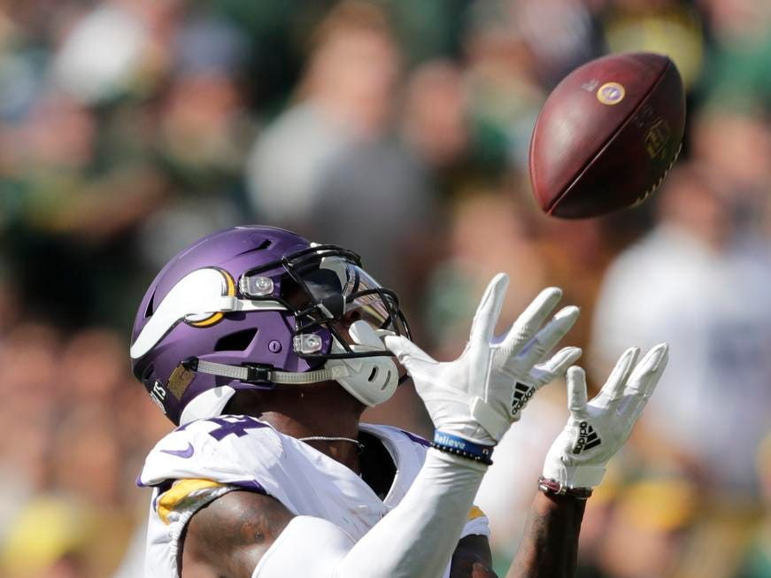 Minnesota Vikings wide receiver Stefon Diggs (14) pulls down a touchdown reception against the Green Bay Packers in the third quarter during their football game Sunday, Sept. 16, 2018, at Lambeau Field in Green Bay, Wis.