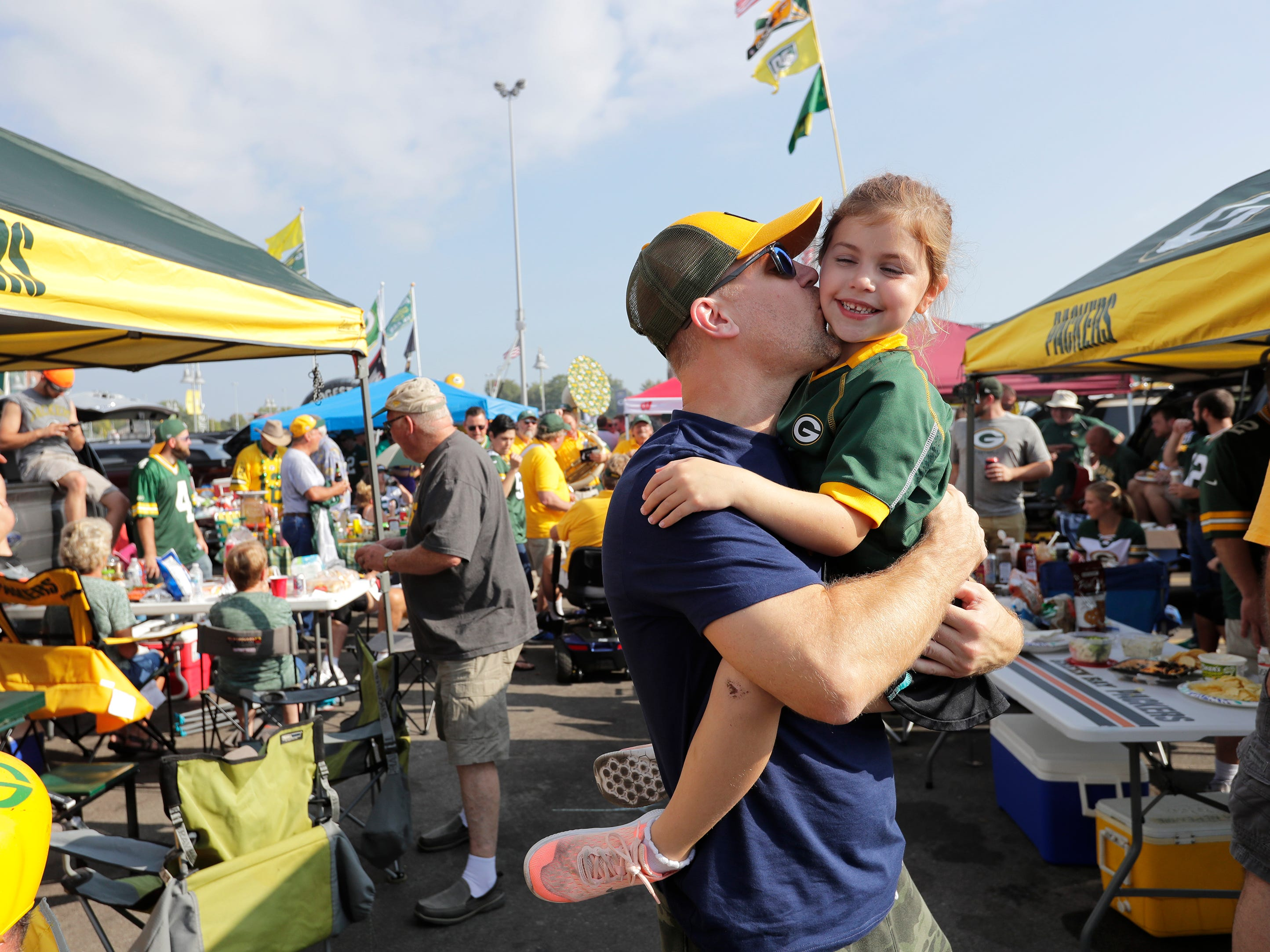 Craig Mickelson of Mahtomedi, MN, and his daughter Zoey, 6, have fun tailgating before the Green Bay Packers play against the Minnesota Vikings Sunday, Sept. 16, 2018, at Lambeau Field in Green Bay, Wis.