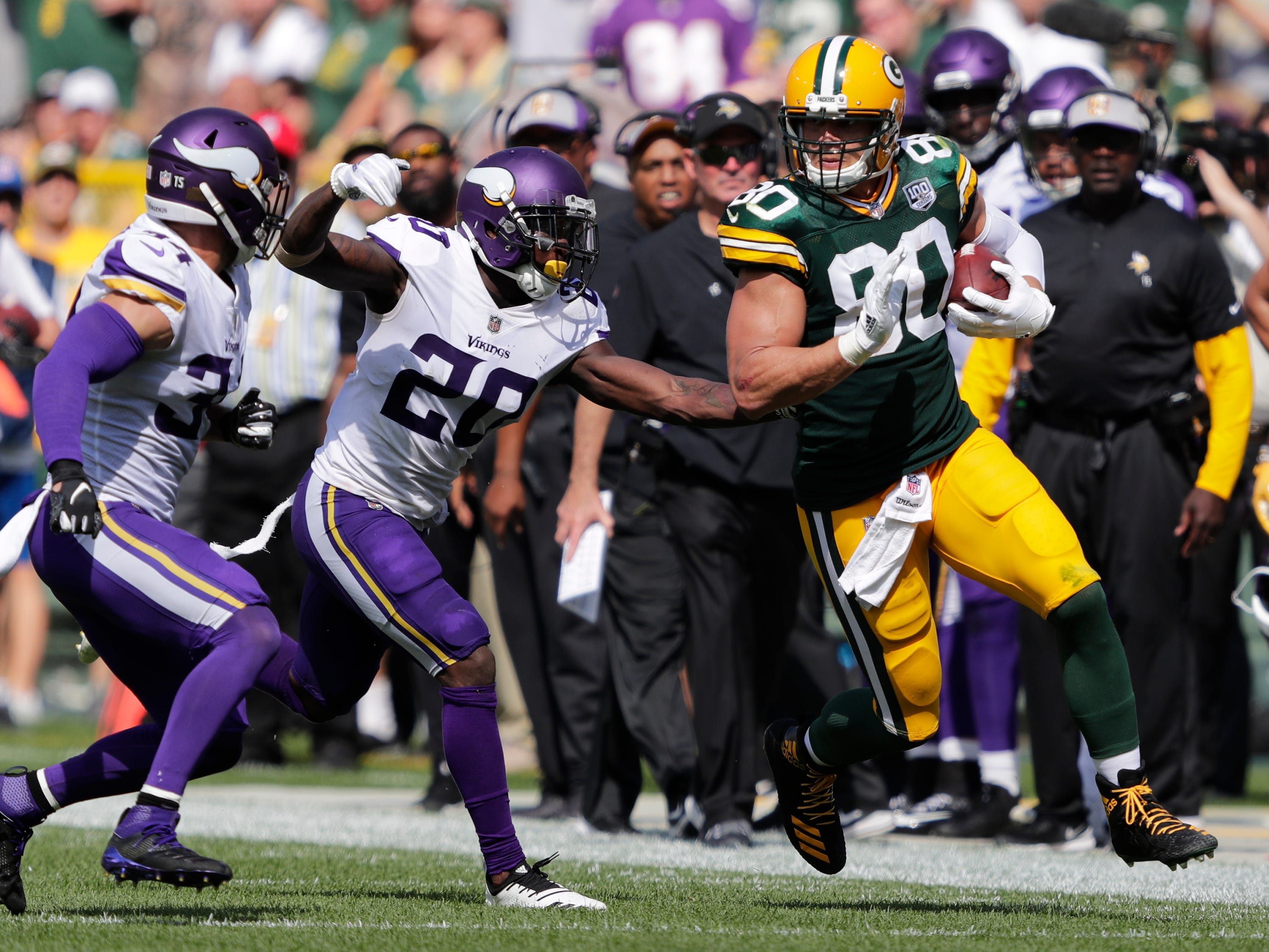 Green Bay Packers tight end Jimmy Graham (80) breaks away on a long reception against Minnesota Vikings defensive back Andrew Sendejo (34) and cornerback Mackensie Alexander (20) in the third quarter during their football game Sunday, Sept. 16, 2018, at Lambeau Field in Green Bay, Wis.