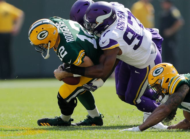 Minnesota Vikings defensive end Everson Griffen (97) sacks Green Bay Packers quarterback Aaron Rodgers (12) in the first quarter at Lambeau Field on Sunday, September 16, 2018 in Green Bay, Wis.