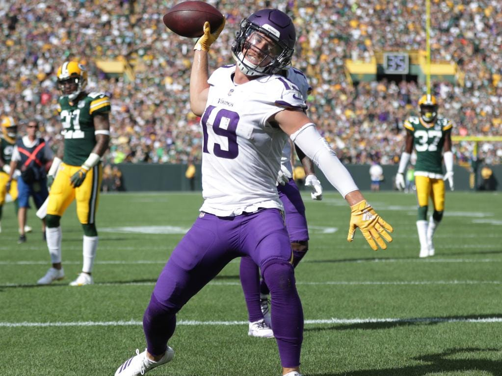 Minnesota Vikings' Adam Thielen scores a late fourth quarter touchdown during against the Green Bay Packersduring their football game  on Sunday, September 16, 2018, at Lambeau Field in Green Bay, Wis. The game ended in a 29 to 29 tie.