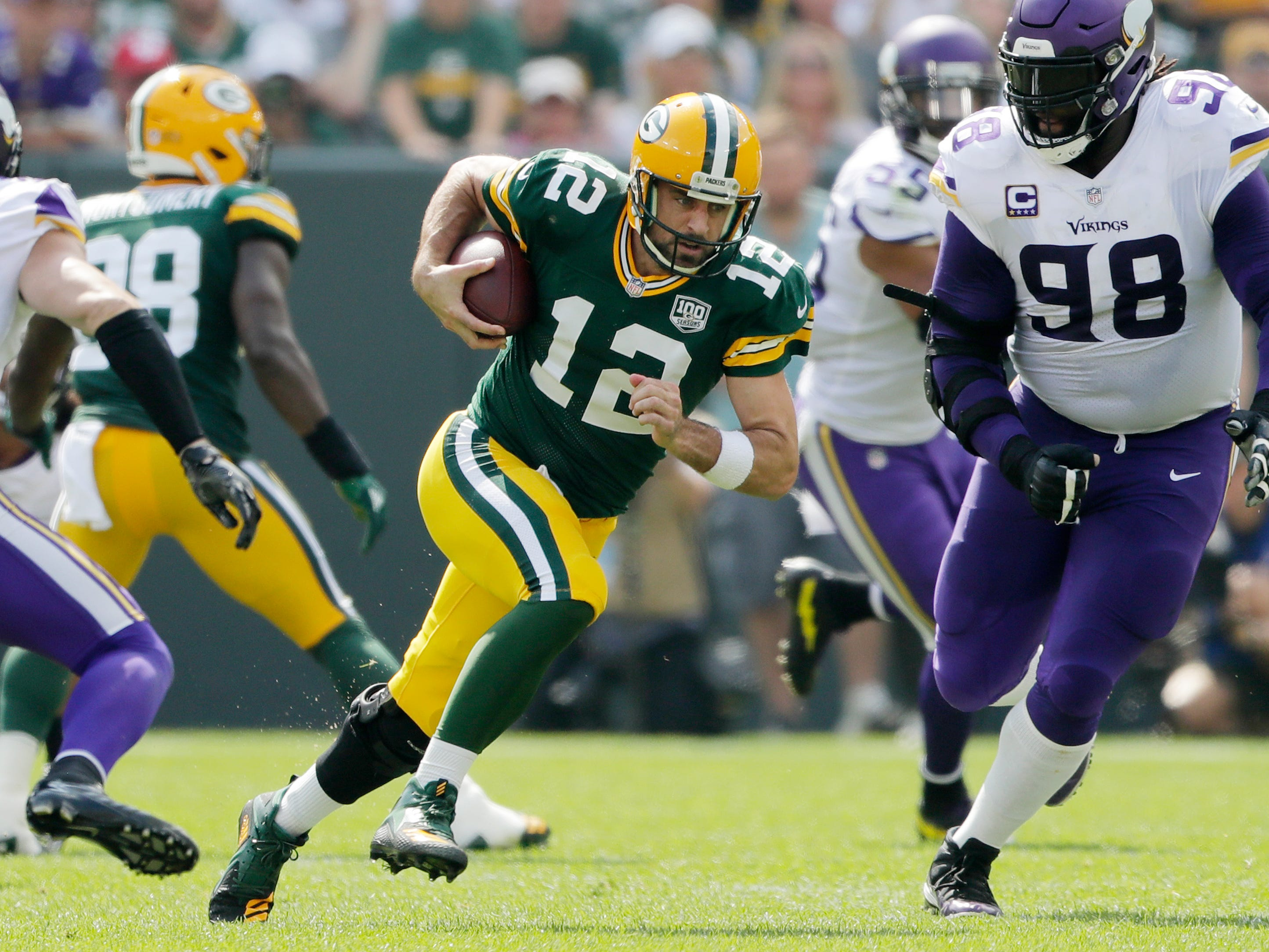 Green Bay Packers quarterback Aaron Rodgers (12) scrambles in the first quarter against the Minnesota Vikings at Lambeau Field on Sunday, September 16, 2018 in Green Bay, Wis.