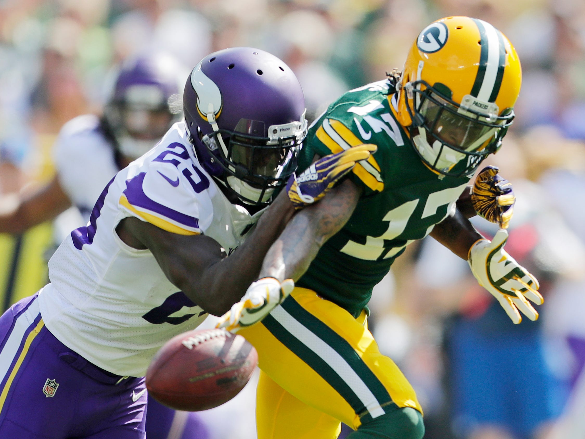 Minnesota Vikings defensive back Xavier Rhodes (29) breaks up a pass intended for Green Bay Packers wide receiver Davante Adams (17) in the first quarter at Lambeau Field on Sunday, September 16, 2018 in Green Bay, Wis.