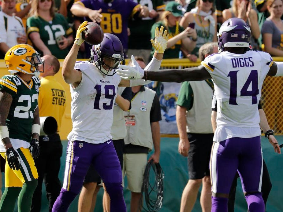 Minnesota Vikings wide receiver Adam Thielen (19) celebrates scoring a touchdown against Green Bay Packers cornerback Jaire Alexander (23) late in the fourth quarter during their football game Sunday, Sept. 16, 2018, at Lambeau Field in Green Bay, Wis. The Vikings scored a two point conversion to tie the game.