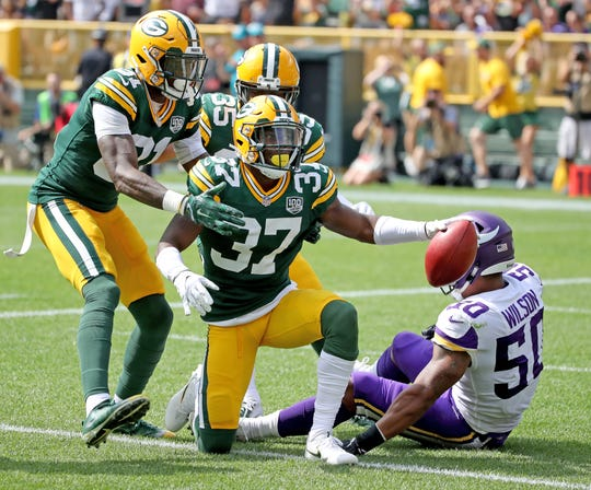 Green Bay Packers cornerback Josh Jackson (37) scores a touchdown off a blocked punt by wide receiver Geronimo Allison (81) in the first quarter against the Minnesota Vikings Sunday, September 16, 2018 at Lambeau Field in Green Bay, WIs.