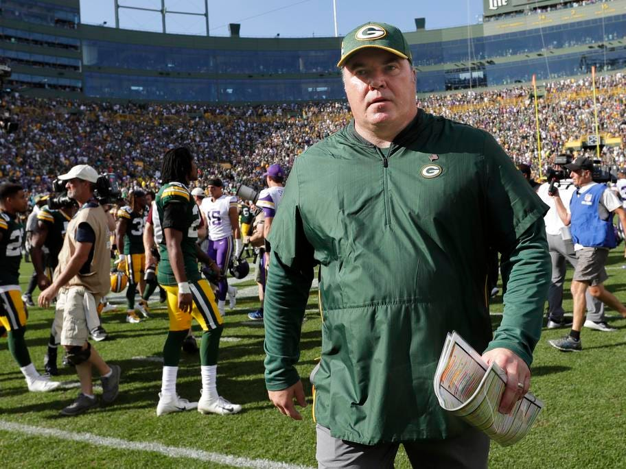 Green Bay Packers coach Mike McCarthy leaves the field after a 29-29 tie against the Minnesota Vikings during their football game Sunday, Sept. 16, 2018, at Lambeau Field in Green Bay, Wis.