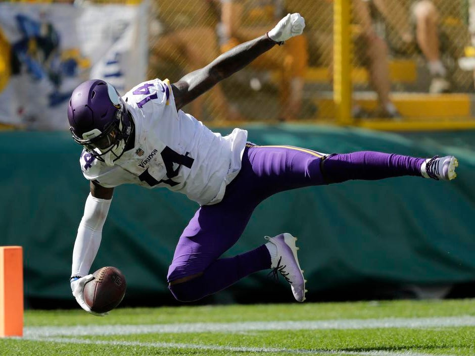 Minnesota Vikings wide receiver Stefon Diggs (14) dives into the end zone for a touchdown reception against the Green Bay Packers in the third quarter during their football game Sunday, Sept. 16, 2018, at Lambeau Field in Green Bay, Wis.