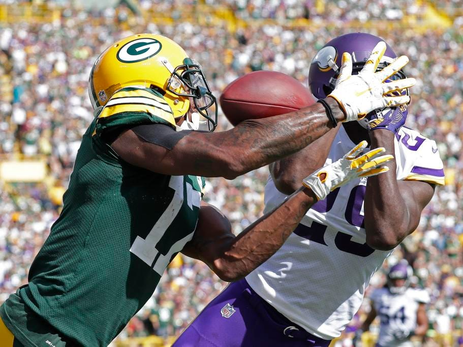 Minnesota Vikings defensive back Xavier Rhodes (29) breaks up a pass intended for Green Bay Packers wide receiver Davante Adams (17) in the fourth quarter at Lambeau Field on Sunday, September 16, 2018 in Green Bay, Wis.