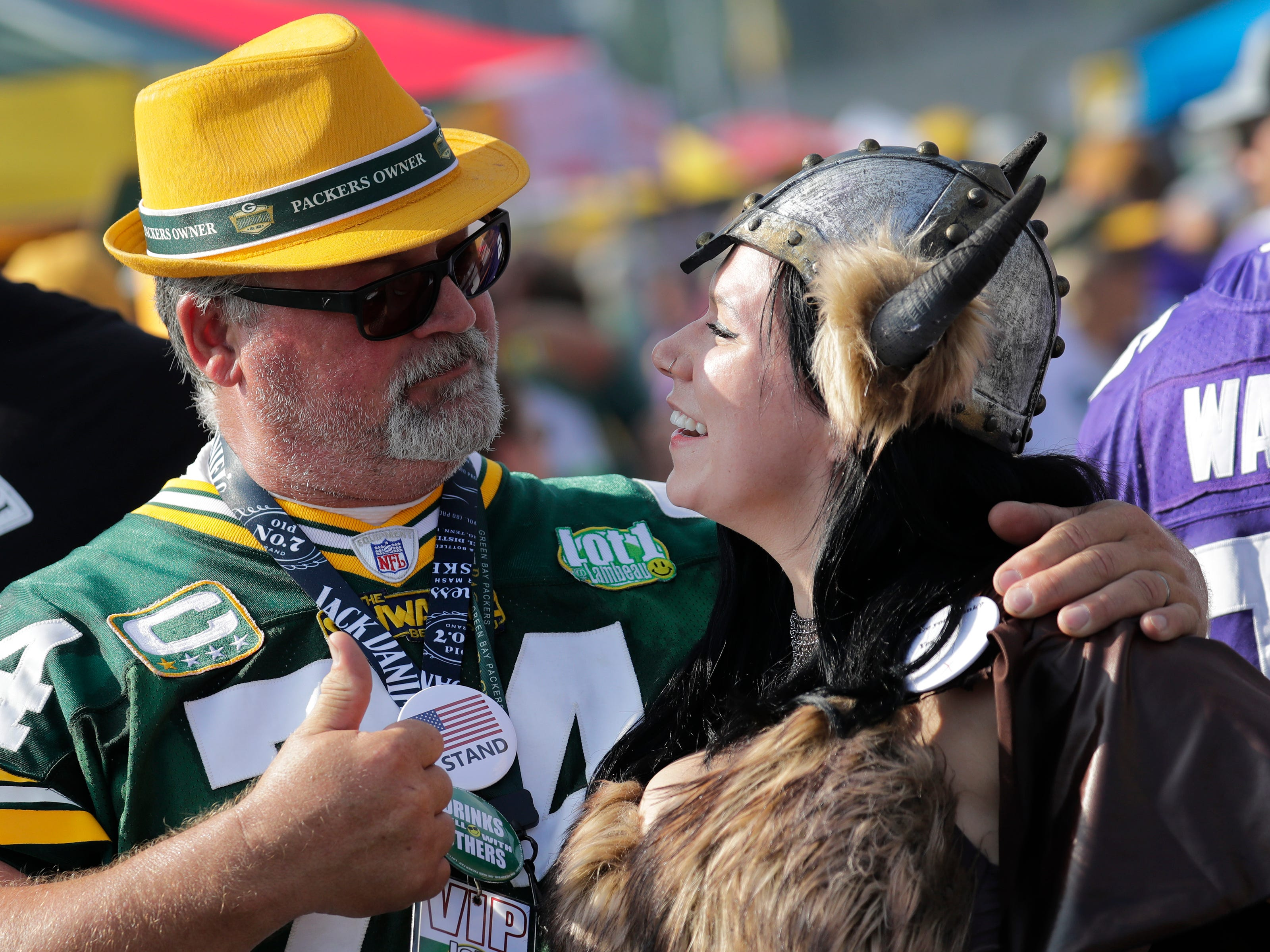 Scott Schwartz, left, of Pulaski, WI, and  Amber Reynolds of Minneapolis, MN, hang out prior to the Green Bay Packers playing against the Minnesota Vikings Sunday, Sept. 16, 2018, at Lambeau Field in Green Bay, Wis.