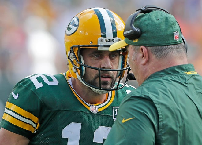 Green Bay Packers quarterback Aaron Rodgers (12) talks to Green Bay Packers head coach Mike McCarthy during the fourth quarter against the Minnesota Vikings at Lambeau Field on Sunday, September 16, 2018 in Green Bay, Wis.