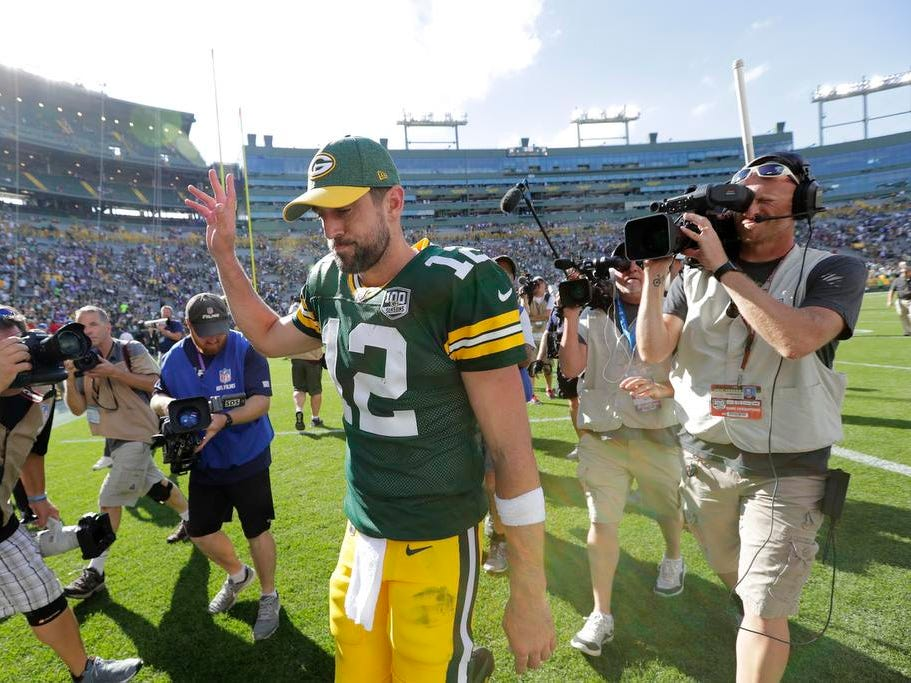 Green Bay Packers quarterback Aaron Rodgers (12) waves to the crowd after a 29-29 tie against the Minnesota Vikings during their football game Sunday, Sept. 16, 2018, at Lambeau Field in Green Bay, Wis.