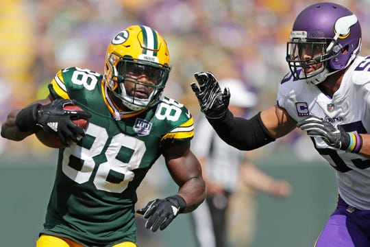 Green Bay Packers running back Ty Montgomery (88) rushes against Minnesota Vikings linebacker Anthony Barr (55) in the second quarter at Lambeau Field on Sunday, September 16, 2018 in Green Bay, Wis.