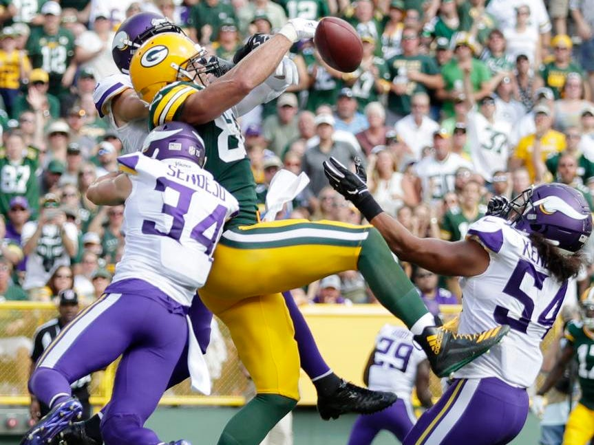 Green Bay Packers tight end Jimmy Graham (80) can't hold on to a pass on the goal line against triple coverage by the Minnesota Vikings in the second half at Lambeau Field on Sunday, September 16, 2018 in Green Bay, Wis.