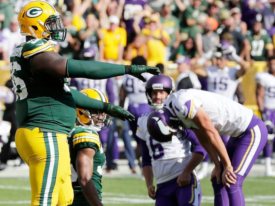 Green Bay Packers defensive end Muhammad Wilkerson (96) reacts as Minnesota Vikings kicker Daniel Carlson (7) missed a field goal as time expired in overtime at Lambeau Field on Sunday, September 16, 2018 in Green Bay, Wis.
