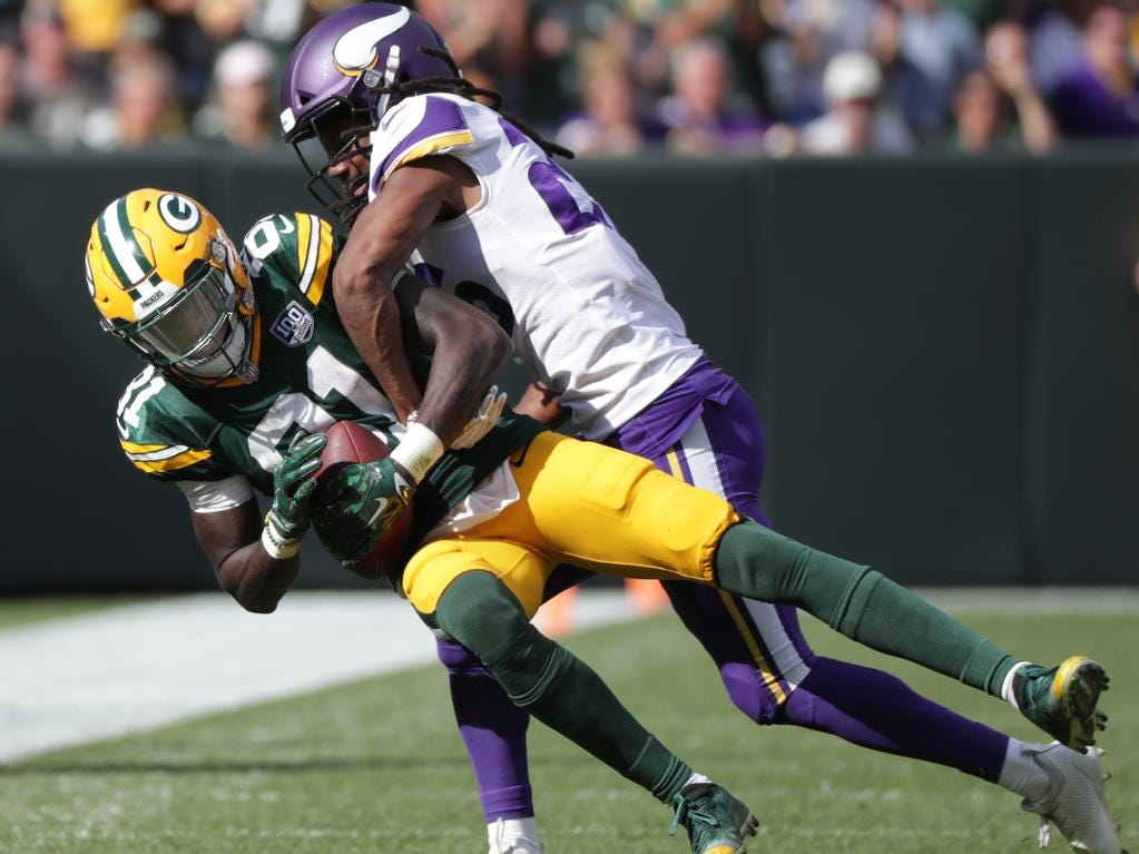 Green Bay Packers' Geronimo Allison catches a pass in front 0f Minnesota Vikings' Trae Waynes during their football game on Sunday, September 16, 2018, at Lambeau Field in Green Bay, Wis. The game ended in a 29 to 29 tie.