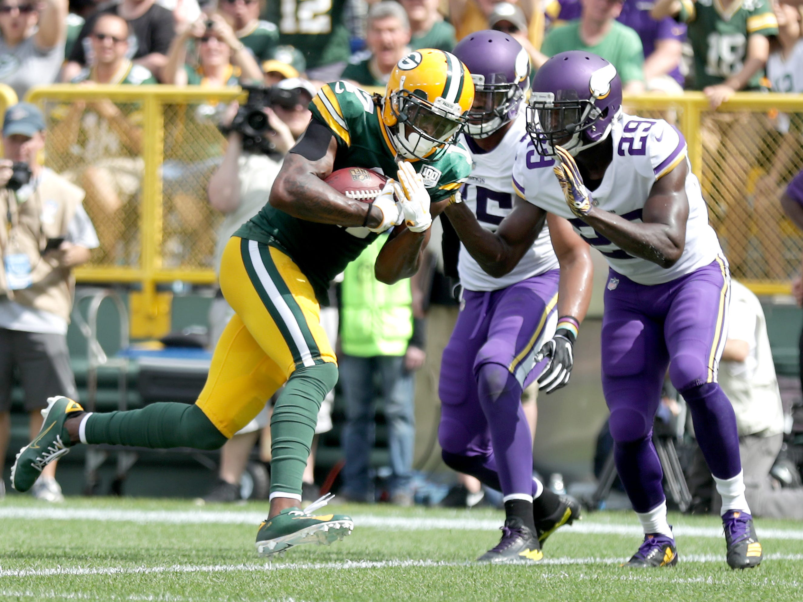 Green Bay Packers' Davante Adams crosses the goal line in the first half against the Minnesota Vikings during their football game on Sunday, September 16, 2018, at Lambeau Field in Green Bay, Wis.