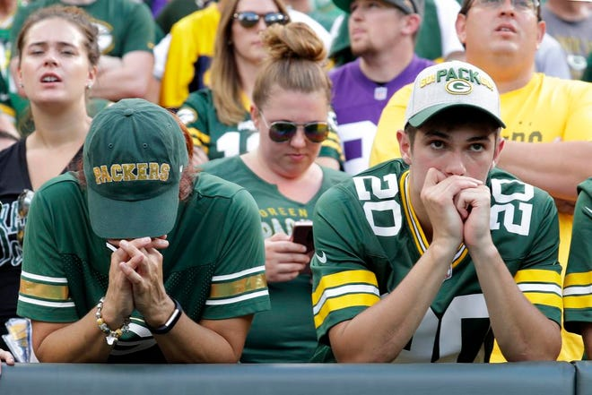 Green Bay Packers fans show their nerves late in the game againt the Minnesota Vikings during their football game Sunday, Sept. 16, 2018, at Lambeau Field in Green Bay, Wis.