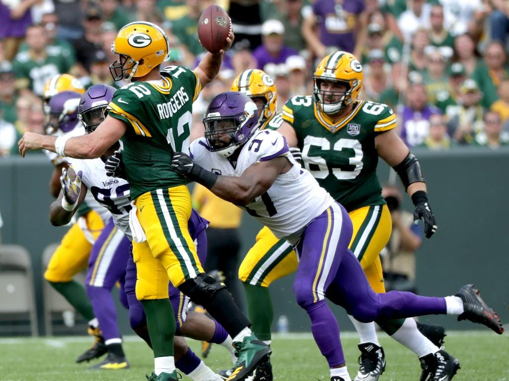 Green Bay Packers quarterback Aaron Rodgers is pressured in the fourth qaurter by Minnesota Vikings defensive end Everson Griffen during their football game on Sunday, September 16, 2018, at Lambeau Field in Green Bay, Wis. The game ended in a 29 to 29 tie.