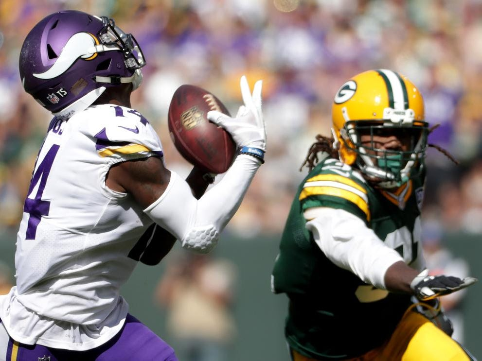 Minnesota Vikings' Stefon Diggs hauls in a touchdown pass in the fourth quarter with Green Bay Packers cornerback Davon House in pursuit during their football game on Sunday, September 16, 2018, at Lambeau Field in Green Bay, Wis.
