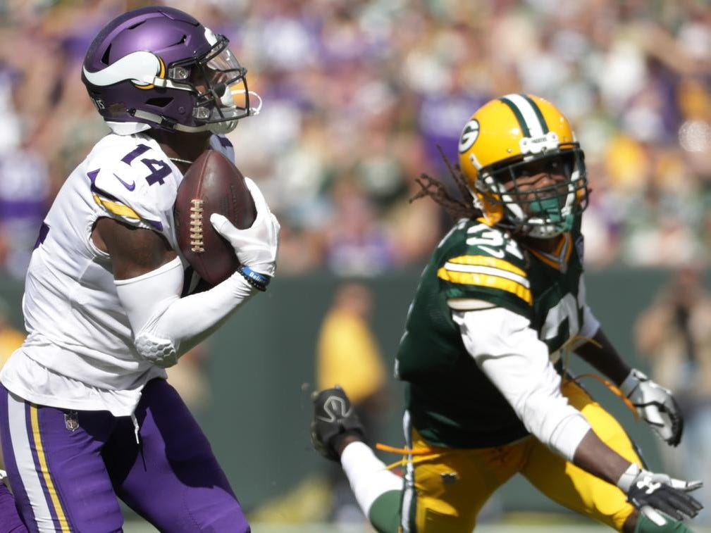 Minnesota Vikings' Stefon Diggs on the recieving end of a catch and run tuchdown inthe fourth quarter against Green Bay Packers' Davon House during their football game on Sunday, September 16, 2018, at Lambeau Field in Green Bay, Wis.