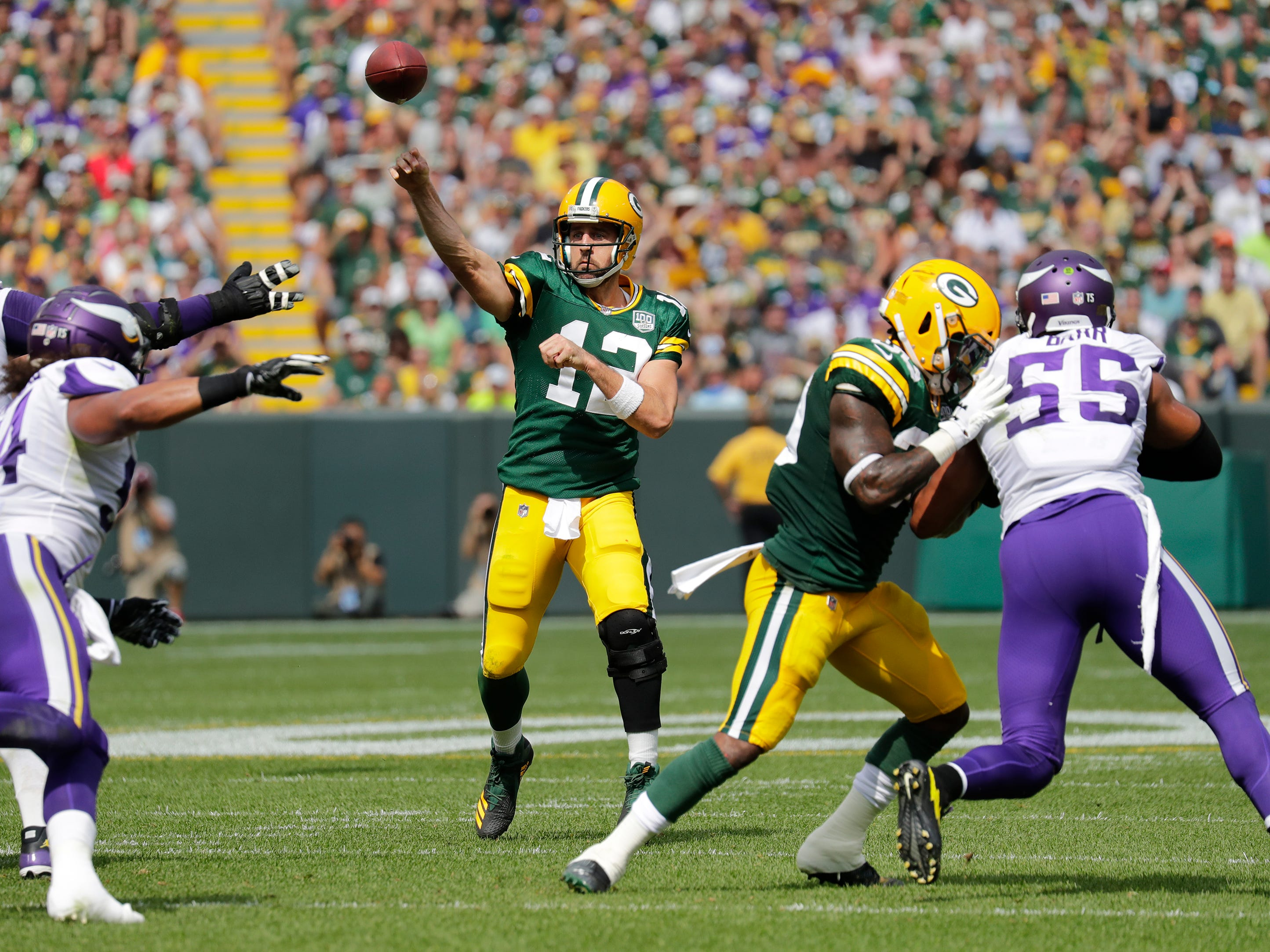 Green Bay Packers quarterback Aaron Rodgers (12) throws a touchdown pass to wide receiver Davante Adams (17) in the second quarter during their football game Sunday, Sept. 16, 2018, at Lambeau Field in Green Bay, Wis.
