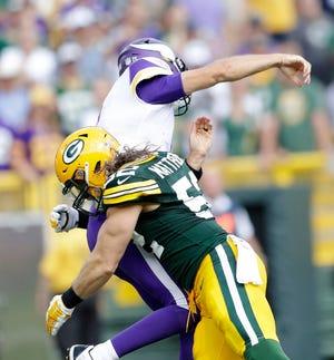 Green Bay Packers linebacker Clay Matthews (52) hits Minnesota Vikings quarterback Kirk Cousins (8) in the fourth quarter against the Minnesota Vikings at Lambeau Field on Sunday, September 16, 2018 in Green Bay, Wis.