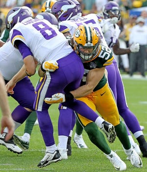Green Bay Packers linebacker Clay Matthews (52) rushes quarterback Kirk Cousins (8) and was called for roughing the passer on the play against the Minnesota Vikings Sunday, September 16, 2018 at Lambeau Field in Green Bay, WIs.