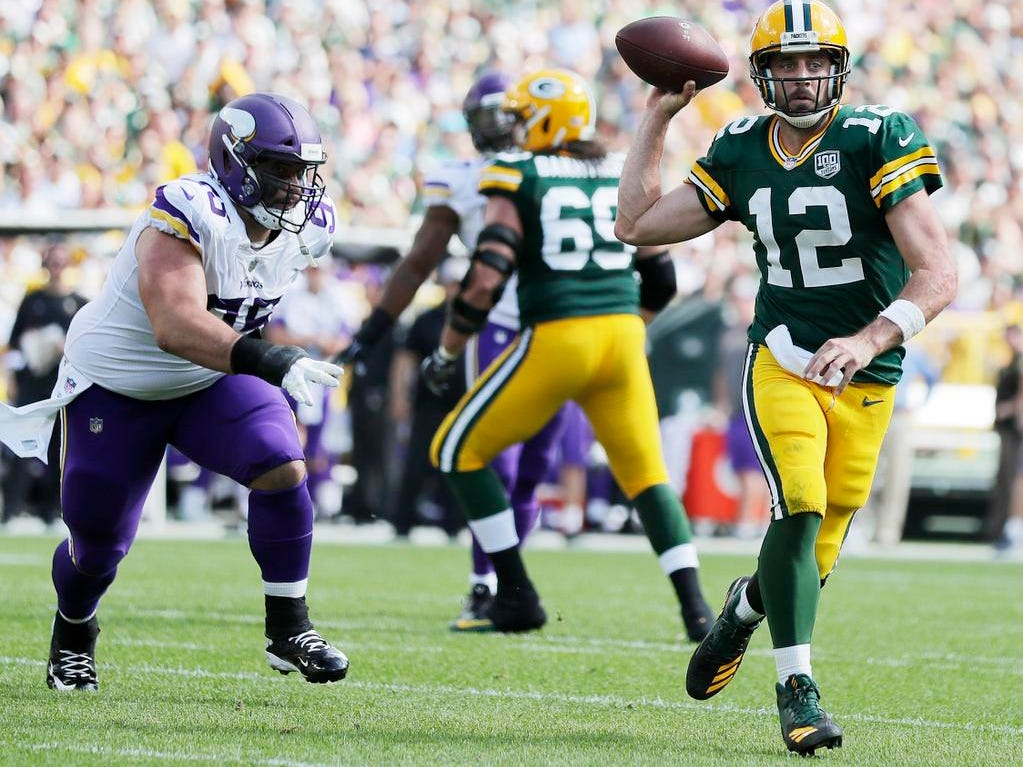 Green Bay Packers quarterback Aaron Rodgers (12) scrambles out of the pocket against the Minnesota Vikings in the fourth quarter at Lambeau Field on Sunday, September 16, 2018 in Green Bay, Wis.