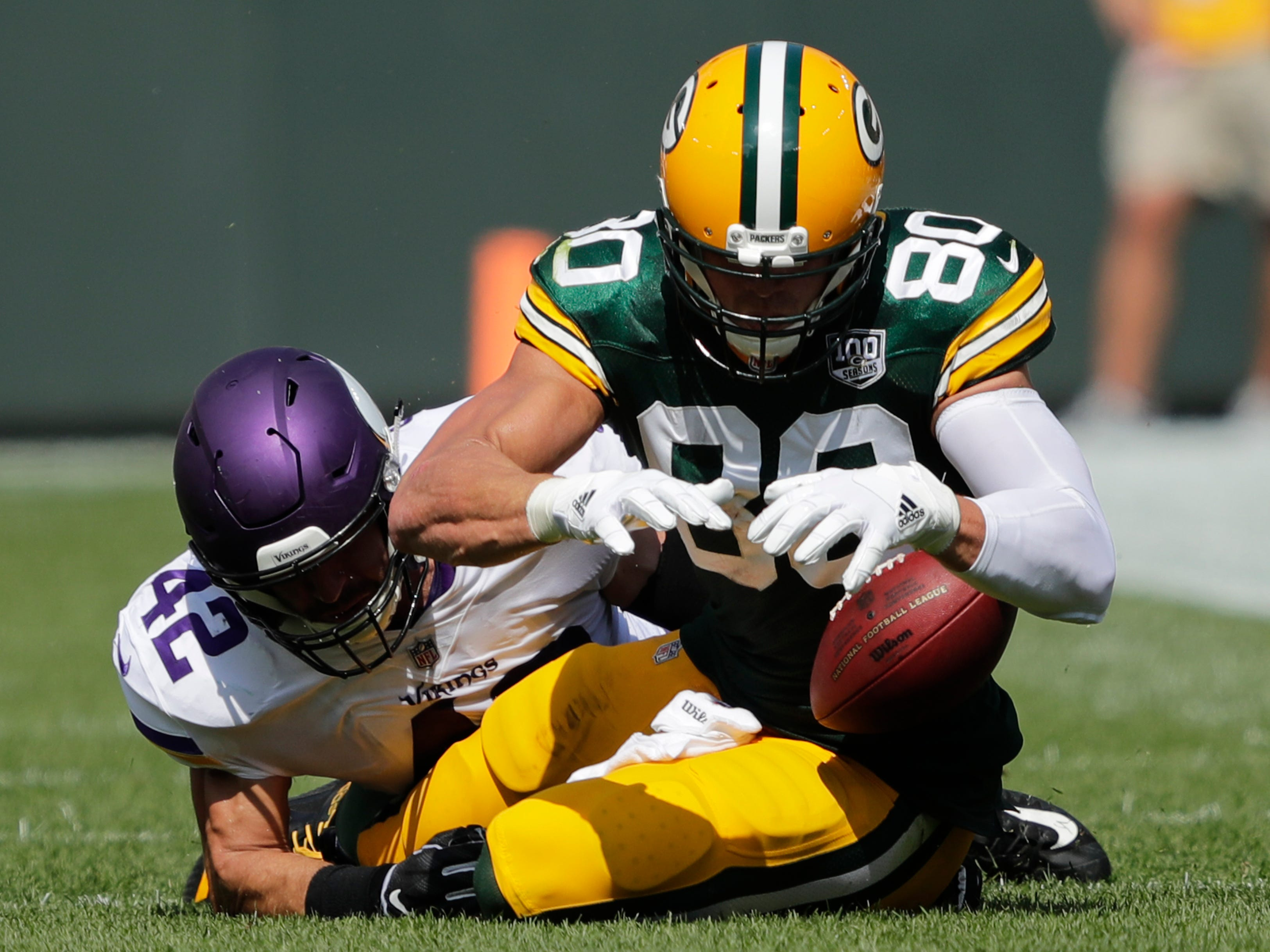 Green Bay Packers tight end Jimmy Graham (80) can't make a catch against Minnesota Vikings linebacker Ben Gedeon (42) in the second quarter during their football game Sunday, Sept. 16, 2018, at Lambeau Field in Green Bay, Wis.