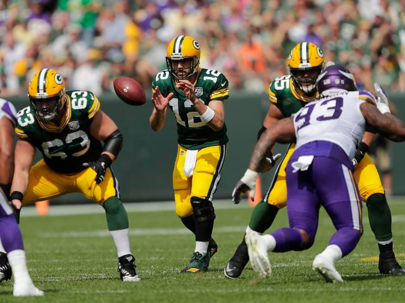 Green Bay Packers quarterback Aaron Rodgers (12) runs the offense in the first half during their football game Sunday, Sept. 16, 2018, at Lambeau Field in Green Bay, Wis.