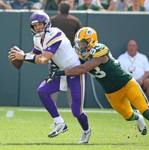 Green Bay Packers linebacker Reggie Gilbert (93) runs down quarterback Kirk Cousins (8) against the Minnesota Vikings Sunday, September 16, 2018 at Lambeau Field in Green Bay, WIs.