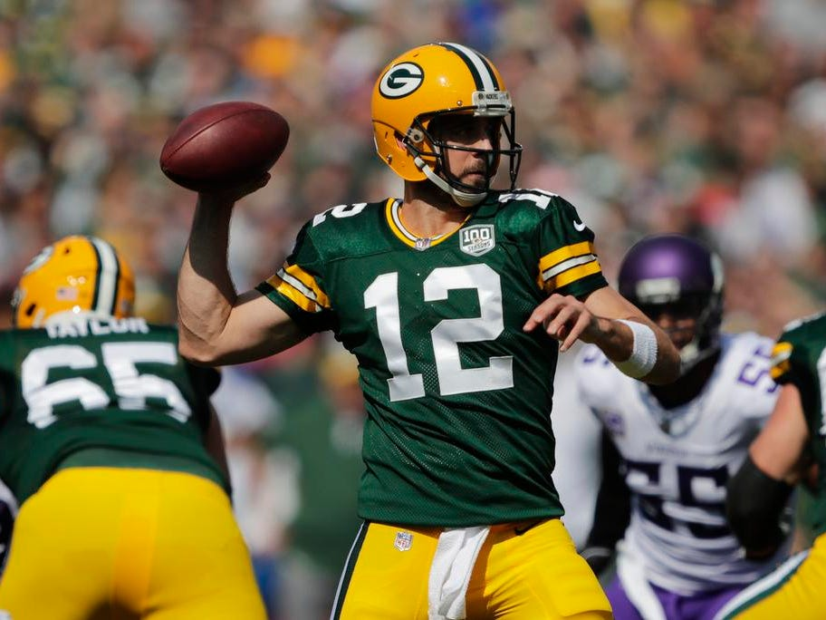 Green Bay Packers quarterback Aaron Rodgers (12) throws in the first quarter against the Minnesota Vikings during their football game Sunday, Sept. 16, 2018, at Lambeau Field in Green Bay, Wis.