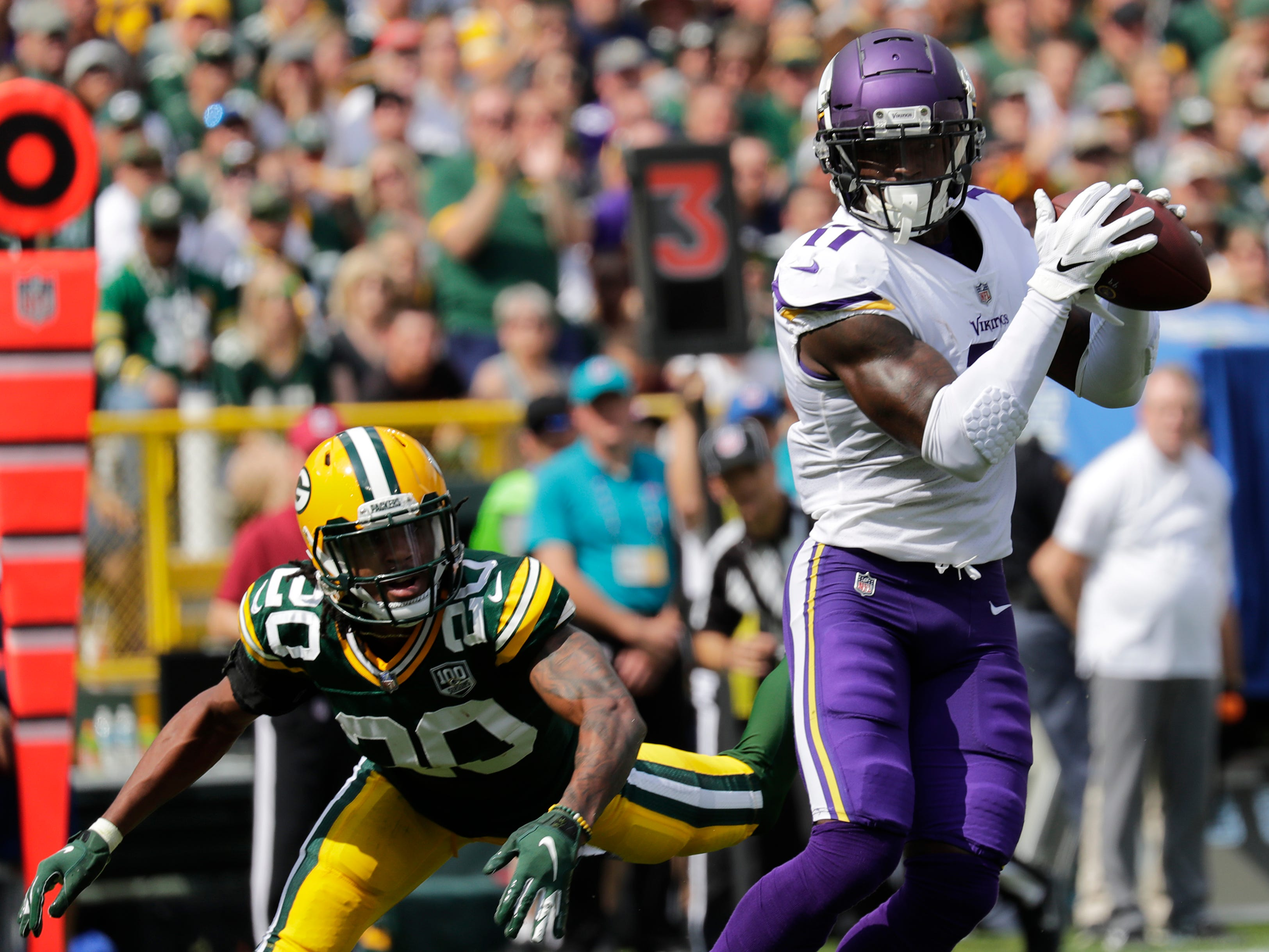 Minnesota Vikings wide receiver Laquon Treadwell (11) scores a touchdon against Green Bay Packers cornerback Kevin King (20) during their football game Sunday, Sept. 16, 2018, at Lambeau Field in Green Bay, Wis.