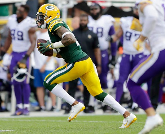 Green Bay Packers defensive back Ha Ha Clinton-Dix (21) runs the ball back after an interception in the fourth quarter against the Minnesota Vikings at Lambeau Field on Sunday, September 16, 2018 in Green Bay, Wis.