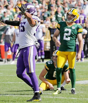 Green Bay Packers kicker Mason Crosby (2) reacts after missing a field goal as Minnesota Vikings linebacker Anthony Barr (55) celebrates in the fourth quarter at Lambeau Field on Sunday, September 16, 2018 in Green Bay, Wis.