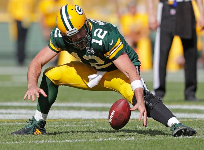 Green Bay Packers quarterback Aaron Rodgers (12) recovers his fumble in overtime against the Minnesota Vikings at Lambeau Field on Sunday, September 16, 2018 in Green Bay, Wis.