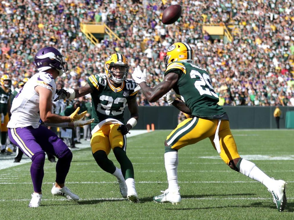 Minnesota Vikings' Adam Thielen scores a late fourth quarter touchdown during against the defense of Green Bay Packers' Jaire Alexander and Kentrell Brice during their football game on Sunday, September 16, 2018, at Lambeau Field in Green Bay, Wis. The game ended in a 29 to 29 tie.
