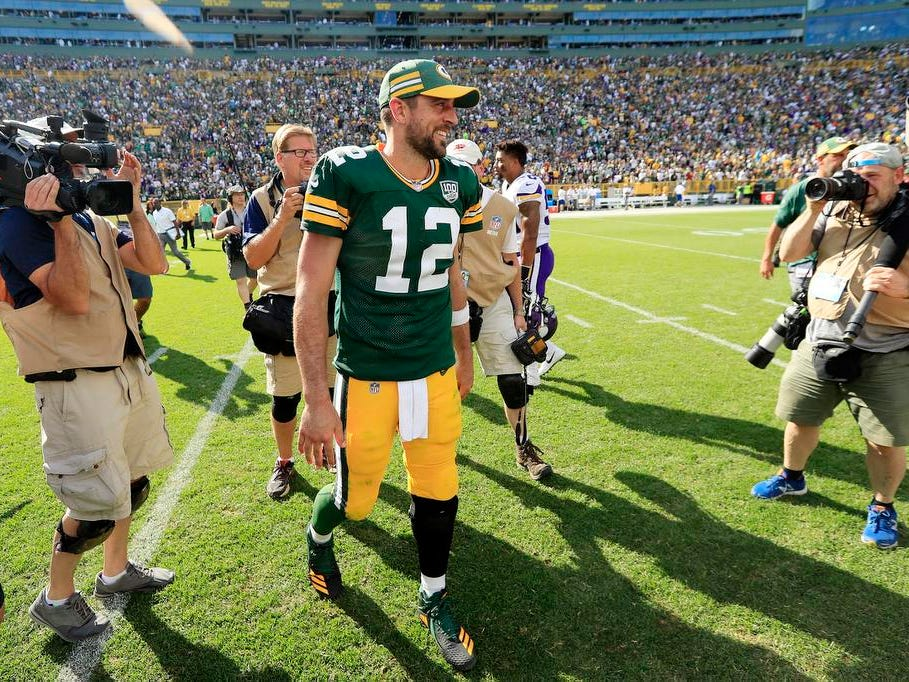 Green Bay Packers quarterback Aaron Rodgers (12) walks off the field after a tie against the Minnesota Vikings at Lambeau Field on Sunday, September 16, 2018 in Green Bay, Wis.
