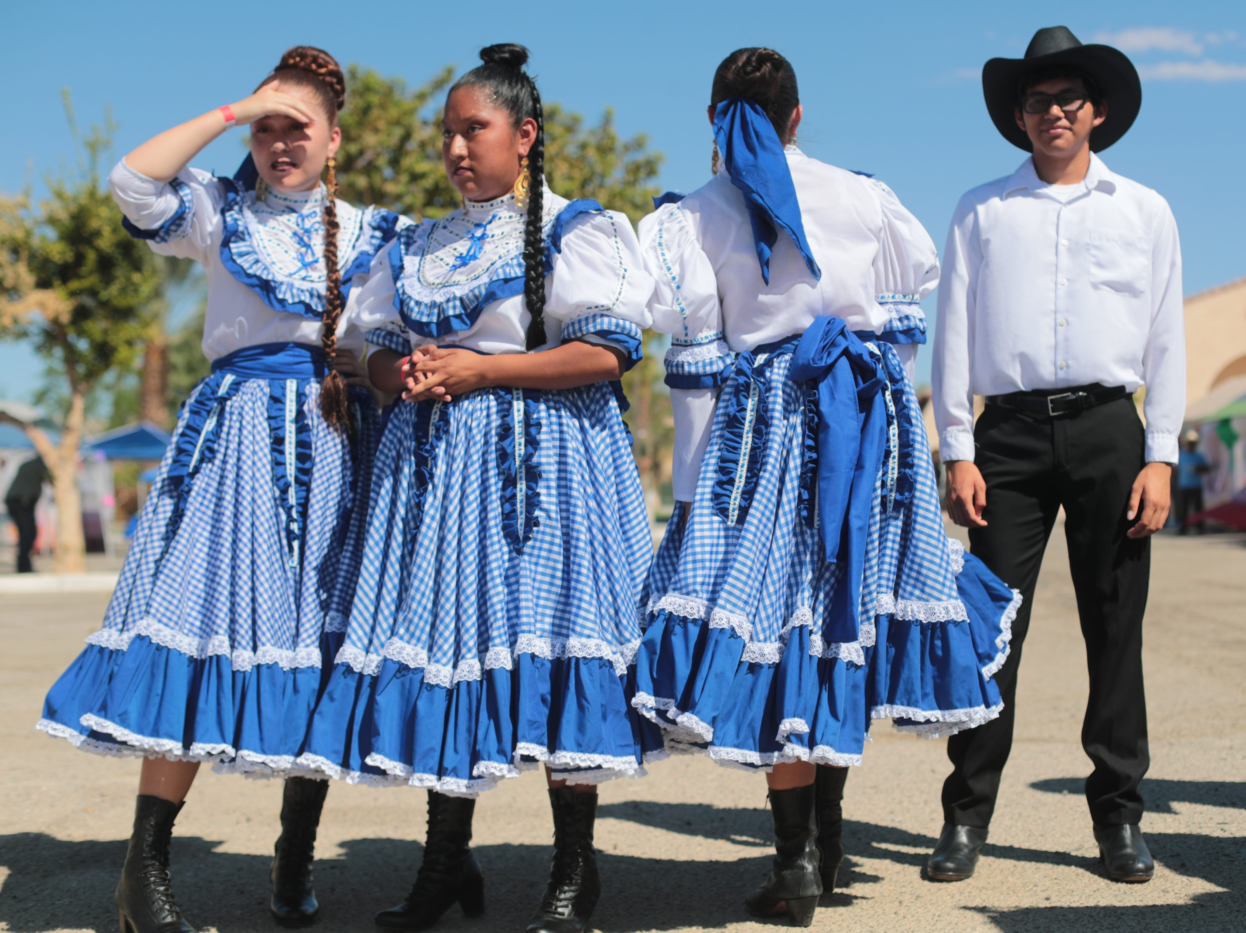 Folkolorico dancers from Desert Mirage High School wait to perform at the Mexican independence day celebration at Our Virgin of Guadalupe Church in Mecca on Saturday, September 15, 2018.