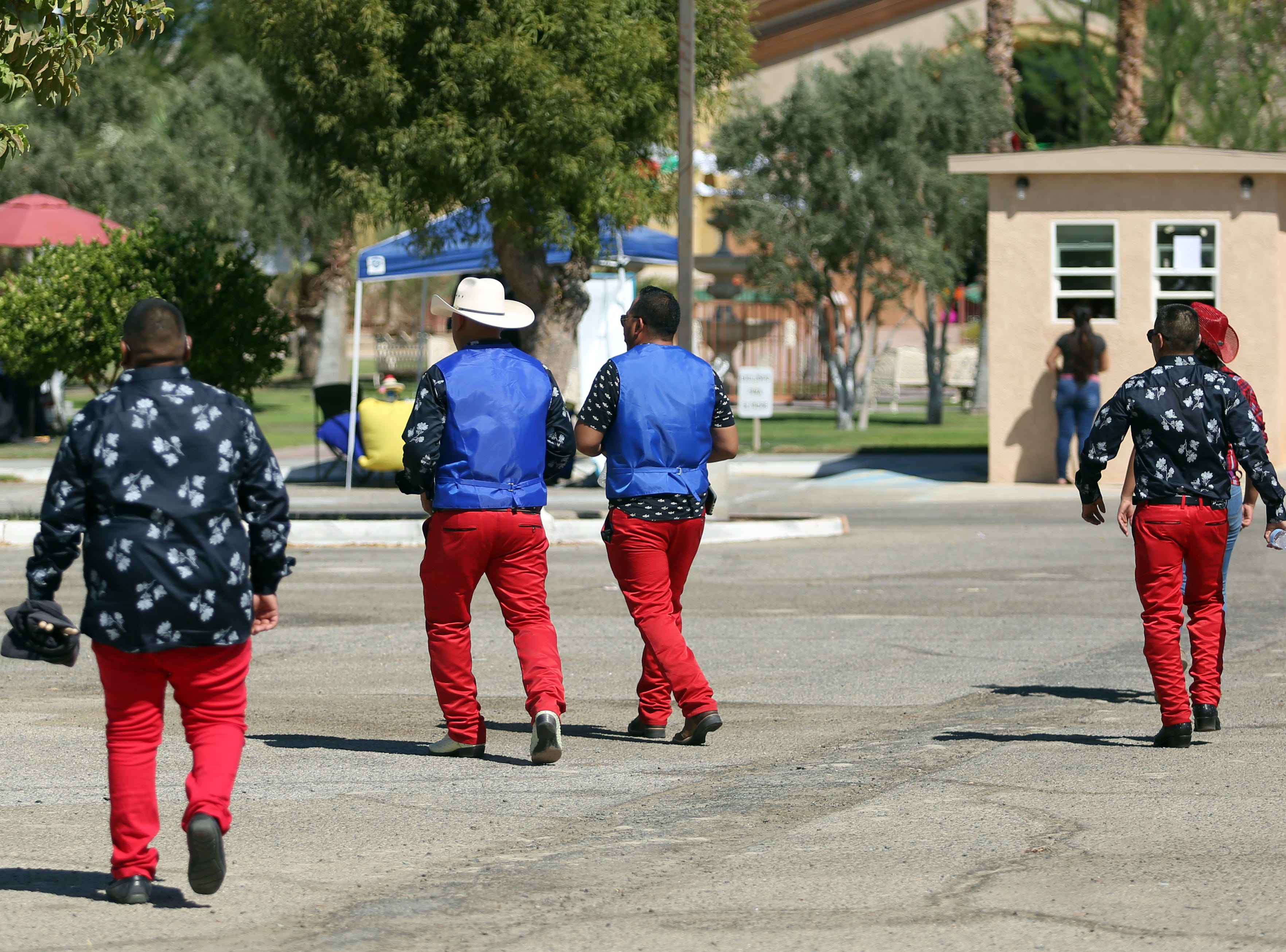 Men in red pants at the Mexican independence day celebration at Our Virgin of Guadalupe Church in Mecca on Saturday, September 15, 2018.