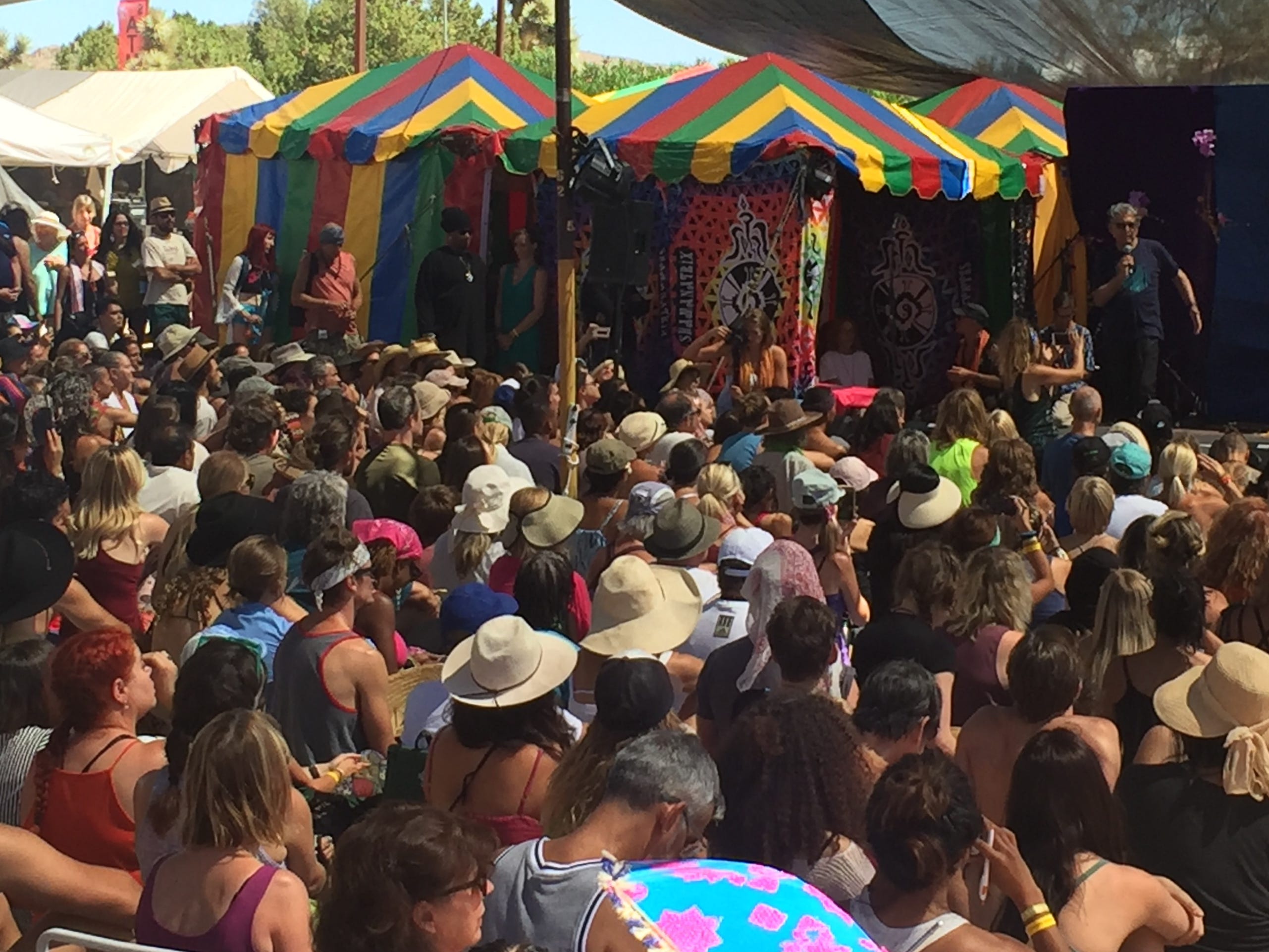 A standing room-only crowd listens Saturday to Deepak Chopra at Bhakti Fest in Joshua Tree. Chopra, an author, medical doctor and alternative medicine advocate is a prominent figure in the New Age movement. He was the event's headline speaker.