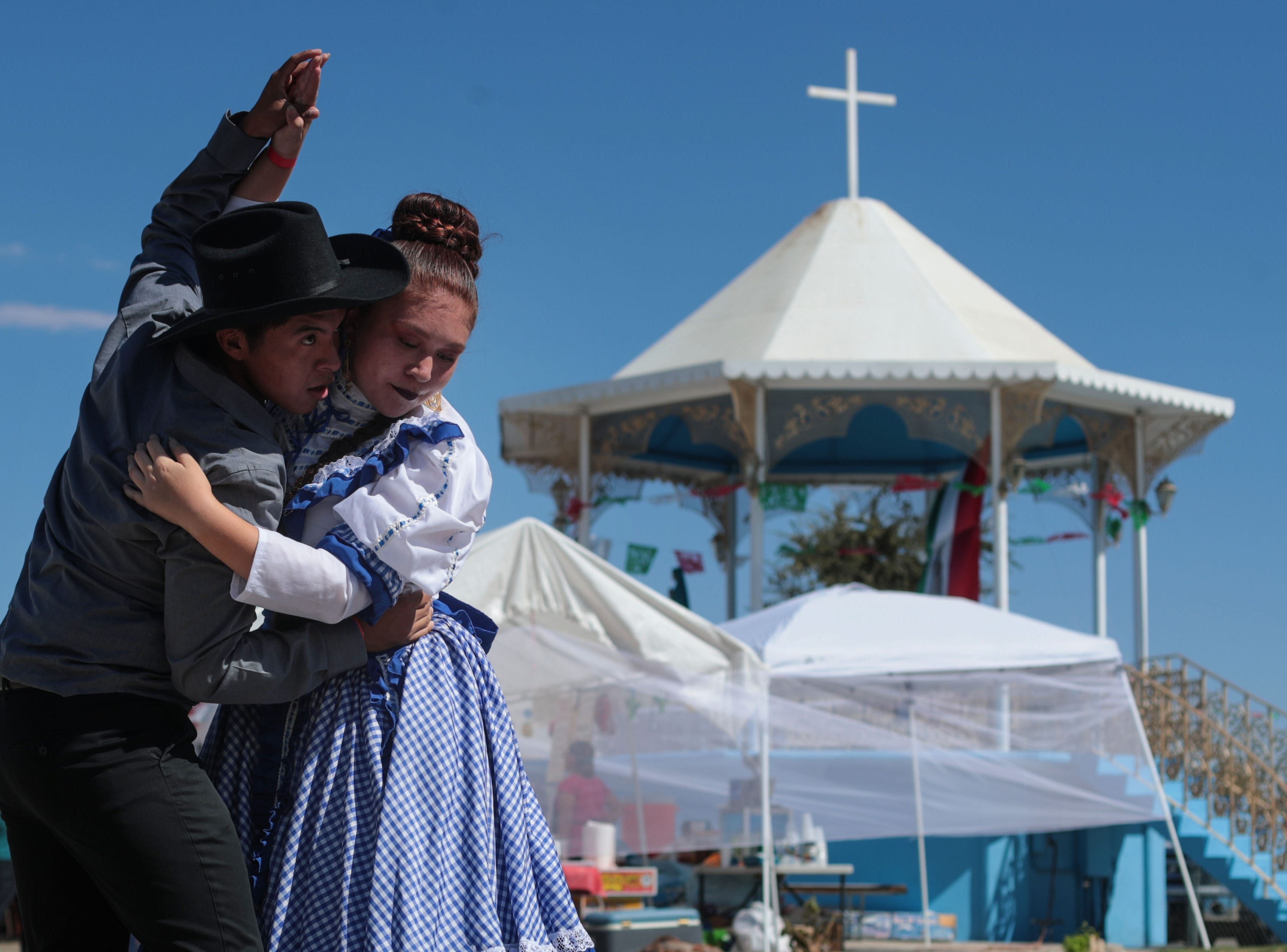 Alejandro Palomares and Blancha Almada from Desert Mirage High School dance at the Mexican independence day celebration at Our Virgin of Guadalupe Church in Mecca on Saturday, September 15, 2018.