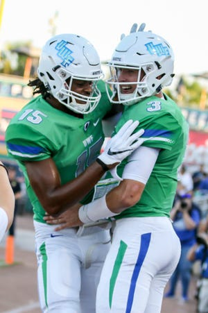 UWF quarterback Sam Vaughn (3) and Kevin Grant (15) celebrate after Vaughn rushed in for a touchdown against Shorter University at Blue Wahoos Stadium on Saturday, September 15, 2018.
