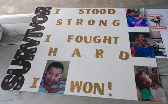 A sign congratulates 8-year-old Dominic Barone for beating cancer. The Pensacola boy celebrated his victory over childhood acute lymphoblastic leukemia at a surprise party Sunday in Cantonment.