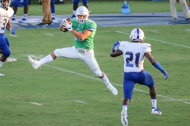 UWF's Tate Lehtio (88) makes a jumping catch against Shorter University at Blue Wahoos Stadium on Saturday, September 15, 2018.