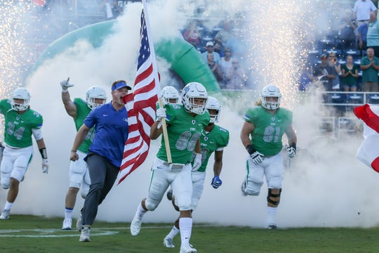 UWF takes the field Saturday night in a fitting, fireworks  and sparkler entrance before a school-record rout against Shorter University