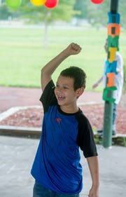 Dominic Barone, 8, reacts Sunday as friends and family surprise him with a party to celebrate his victory over leukemia.